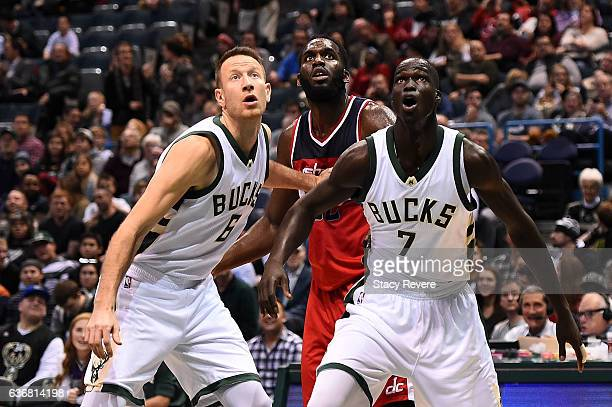 Steve Novak and Thon Maker of the Milwaukee Bucks block out Daniel Ochefu of the Washington Wizards during the second half of a game at the BMO...