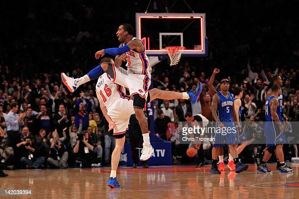 Steve Novak of the New York Knicks and JR Smith of the New York Knicks chest bump after Novak hits a three pointer at the end of the first quarter...