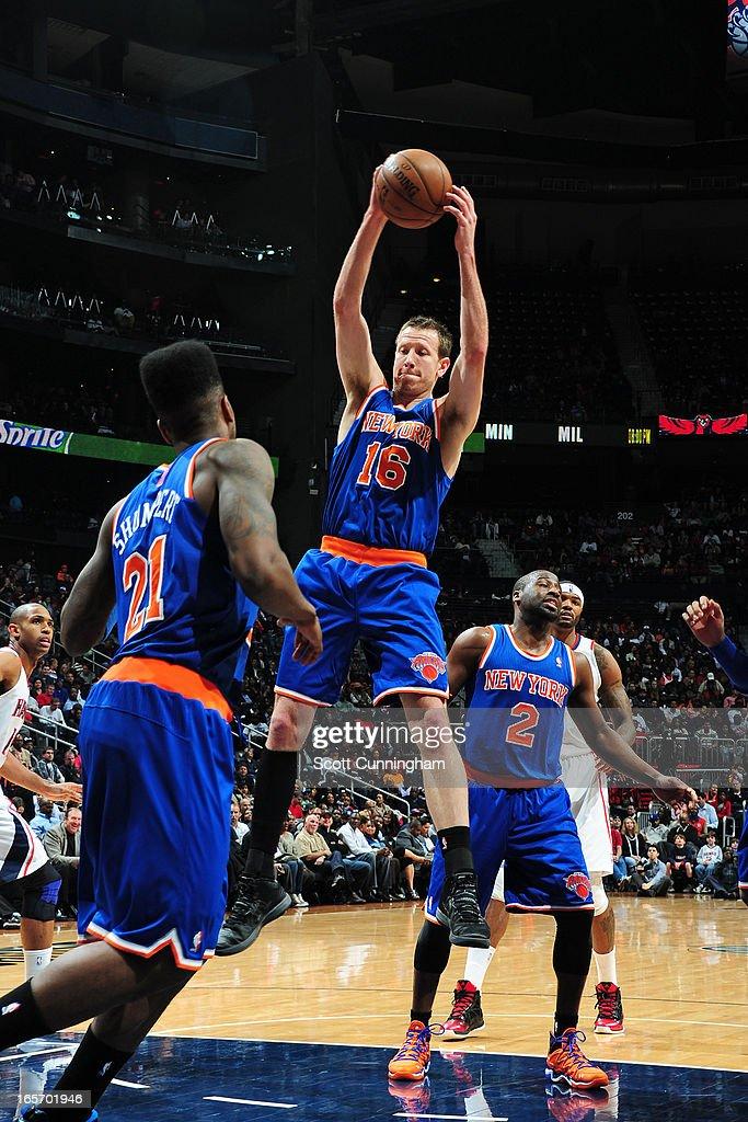 Steve Novak #16 of the New York Knicks grabs a rebound against the Atlanta Hawks on April 3, 2013 at Philips Arena in Atlanta, Georgia.