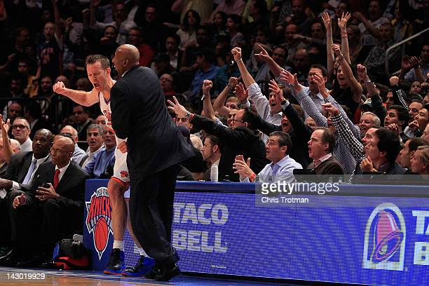 Steve Novak of the New York Knicks reacts with head coach Mike Woodson of the New York Knicks after scoring a three pointer and drawing a foul...