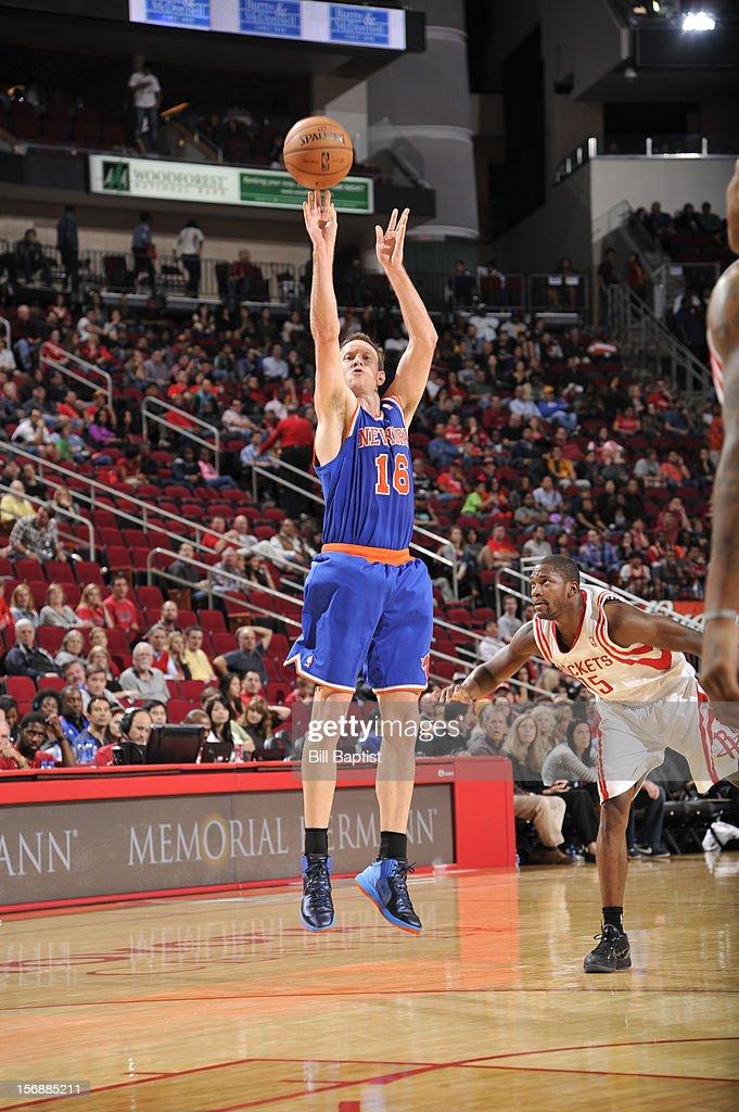 Steve Novak #16 of the New York Knicks shoots the ball over Toney Douglas #15 of the Houston Rockets on November 23, 2012 at the Toyota Center in Houston, Texas.