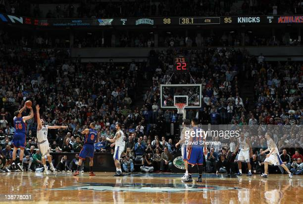 Steve Novak of the New York Knicks shoots the game tying three pointer against Kevin Love of the Minnesota Timberwolves during the game on February...
