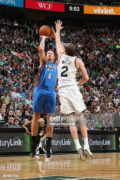 Steve Novak of the Oklahoma City Thunder shoots against Joe Ingles of the Utah Jazz on March 28 2015 at EnergySolutions Arena in Salt Lake City Utah...
