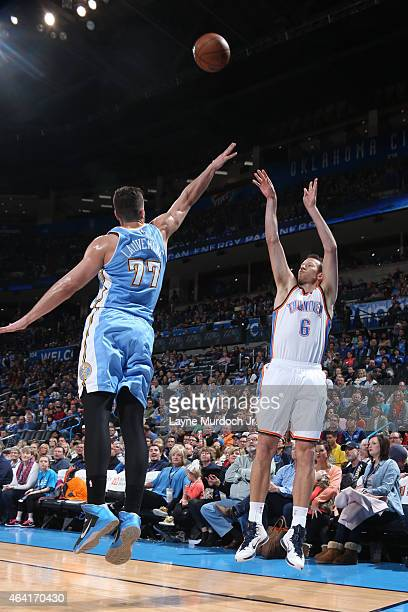Steve Novak of the Oklahoma City Thunder shoots against Joffrey Lauvergne of the Denver Nuggets on February 22 2015 at the Chesapeake Energy Arena in...