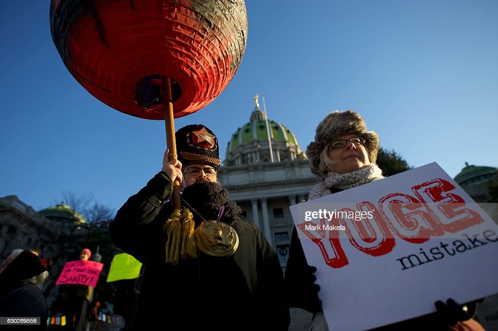 Steve O'Hearn, 58, dressed as a Russian for Trump, joins protestors demonstrating outside the Pennsylvania Capitol Building before electors arrive to cast their votes from the election at December 19, 2016 in Harrisburg, Pennsylvania. Electors from all 50 states cast votes today in their respective state capitols. Donald J. Trump won Pennsylvania by less than 1%, the first Republican to carry the state since George H. W. Bush 1992.