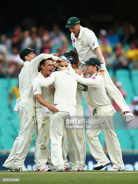 Steve O'Keefe and James Pattinson of Australia celebrate after Joe Burns of Australia caught Jason Holder of West Indies during day one of the third...