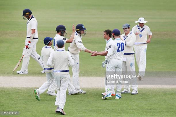 Steve O'Keefe celebrates a wicket during day three of the Sheffield Shield match between Victoria and New South Wales at Junction Oval on March 5...