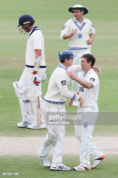 Steve O'Keefe celebrates a wicket with Sean Abbott during day three of the Sheffield Shield match between Victoria and New South Wales at Junction...