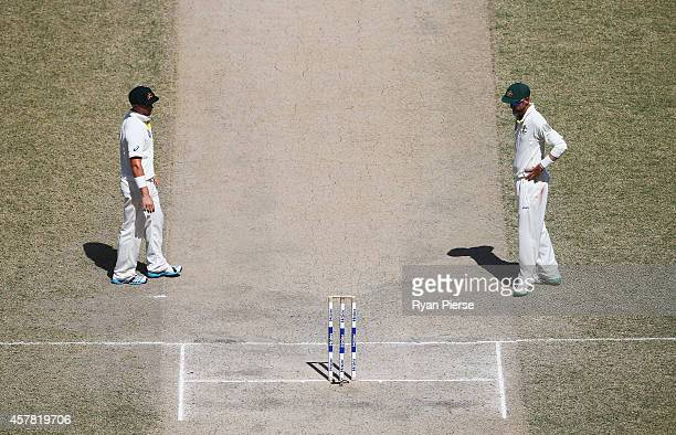 Steve O'Keefe of Australia and Nathan Lyon of Australia discuss the pitch during Day Four of the First Test between Pakistan and Australia at Dubai...