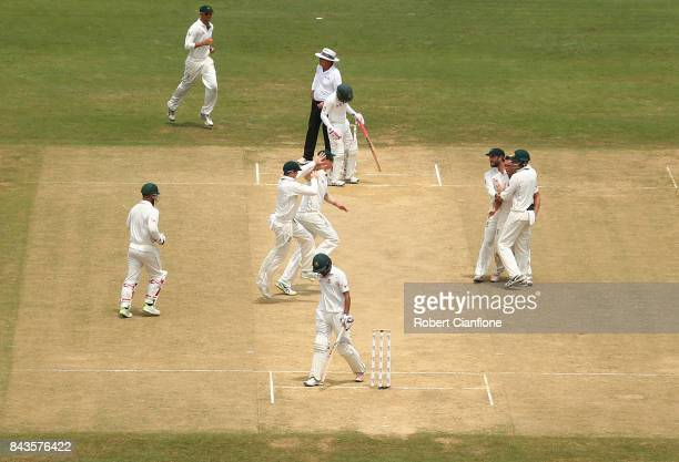 Steve O'Keefe of Australia celebrates after taking the wicket of Nasir Hossain of Bangladesh during day four of the Second Test match between...