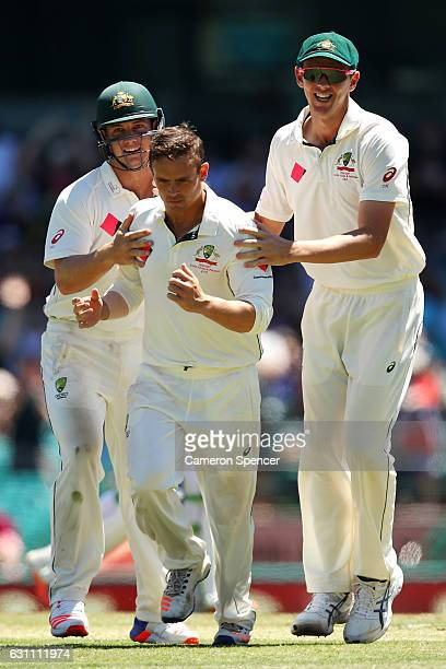 Steve O'Keefe of Australia celebrates with team mates after dismissing MisbahulHaq of Pakistan during day five of the Third Test match between...