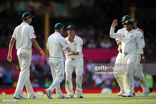 Steve O'Keefe of Australia congratulates team mate David Warner after catching Mohammad Amir of Pakistan off a delivery by Nathan Lyon of Australia...