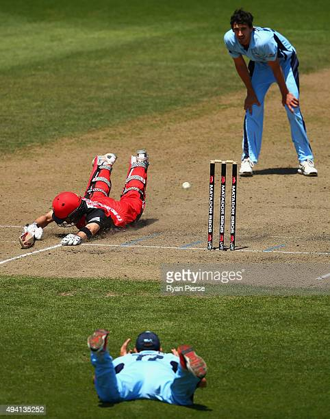 Steve OKeefe of the Blues fails to run out Callum Ferguson of the Redbacks during the Matador BBQs One Day Cup final match between New South Wales...