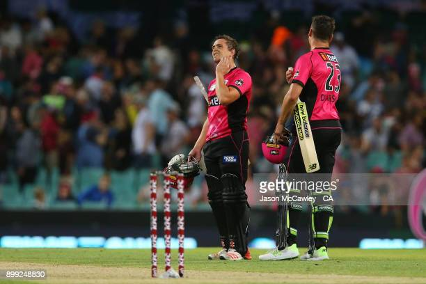 Steve O'Keefe of the Sixers looks dejected after been dismissed by Michael Neser of the Strikers during the Big Bash League match between the Sydney...