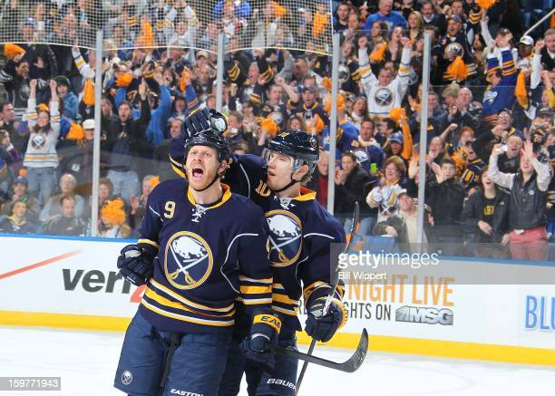 Steve Ott of the Buffalo Sabres celebrates his first period goal with teammate Christian Ehrhoff against the Philadelphia Flyers on January 20 2013...