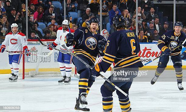 Steve Ott of the Buffalo Sabres celebrates his first-period goal against the Montreal Canadiens with teammate Mike Weber on February 7, 2013 at the...