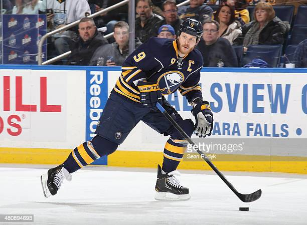 Steve Ott of the Buffalo Sabres controls the puck along the boards against the Pittsburgh Penguins at First Niagara Center on February 5, 2014 in...