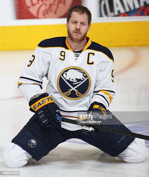 Steve Ott of the Buffalo Sabres stretches in the warmup prior to playing against the Toronto Maple Leafs in an NHL game at the Air Canada Centre on...