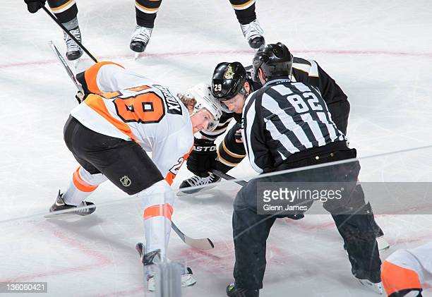 Steve Ott of the Dallas Stars faces off against Claude Giroux of the Philadelphia Flyers at the American Airlines Center on December 21, 2011 in...