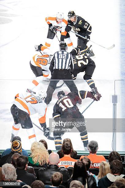 Steve Ott of the Dallas Stars faces off against Danny Briere of the Philadelphia Flyers at the American Airlines Center on December 21, 2011 in...