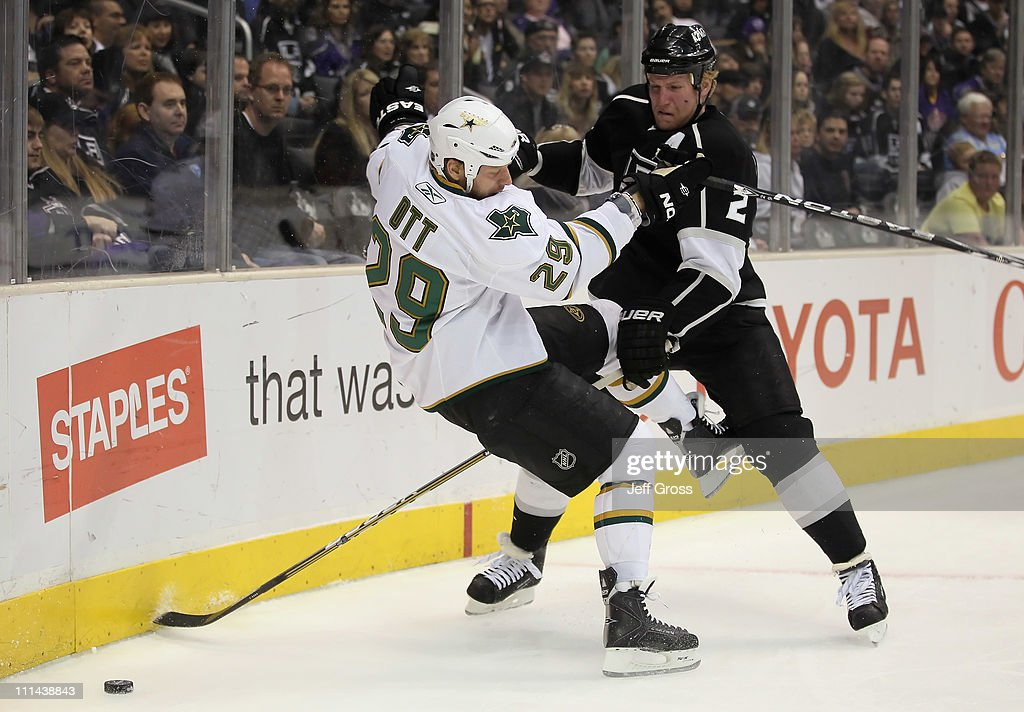 Steve Ott #29 of the Dallas Stars is checked off the puck by Matt Greene #2 of the Los Angeles Kings in the first period at Staples Center on April 2, 2011 in Los Angeles, California.