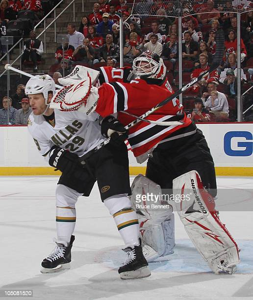 Steve Ott of the Dallas Stars is hit by Martin Brodeur of the New Jersey Devils at the Prudential Center on October 8 2010 in Newark New Jersey The...