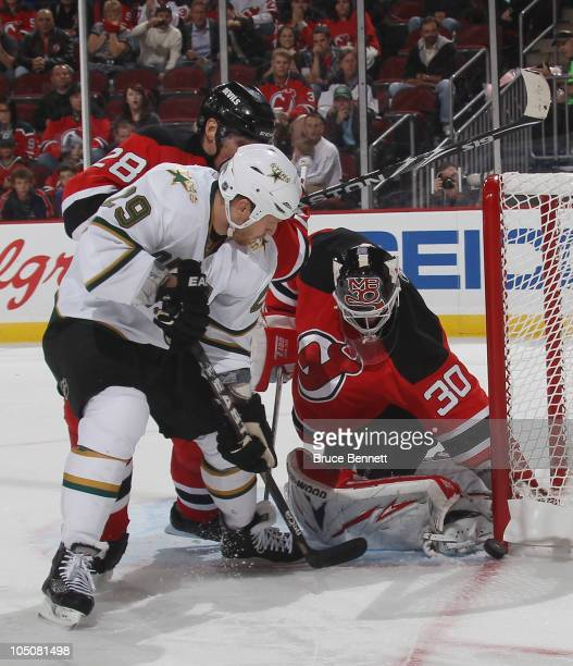 Steve Ott of the Dallas Stars is stopped by Martin Brodeur of the New Jersey Devils at the Prudential Center on October 8 2010 in Newark New Jersey...