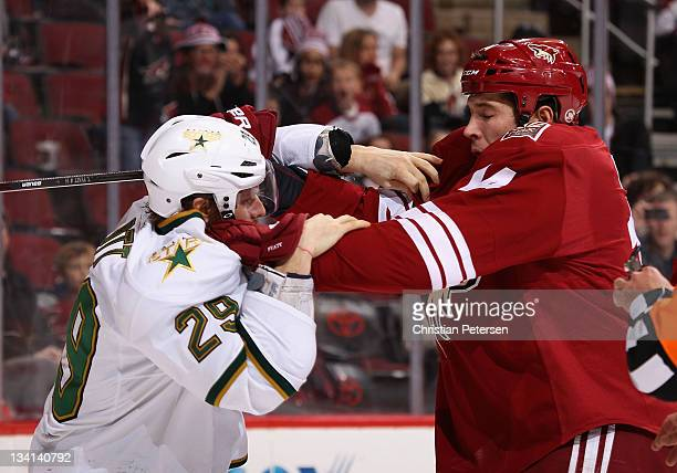 Steve Ott of the Dallas Stars scrums with Taylor Pyatt of the Phoenix Coyotes during the third period of the NHL game at Jobingcom Arena on November...