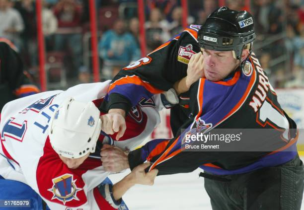 Steve Ott of the Hamilton Bulldogs and Mark Murphy of the Philadelphia Phantoms fight during the American Hockey League game on October 22, 2004 at...