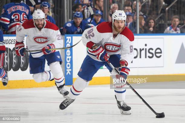 Steve Ott of the Montreal Canadiens skates with the puck against the New York Rangers in Game Three of the Eastern Conference First Round during the...