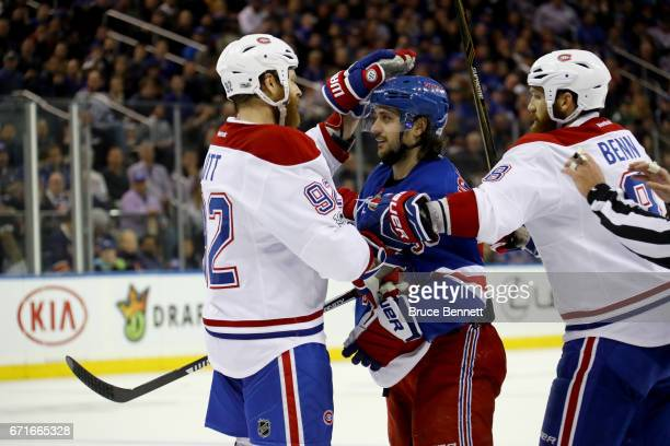 Steve Ott of the Montreal Canadiens taps Mats Zuccarello of the New York Rangers on the head during the second period in Game Six of the Eastern...