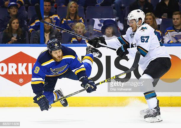 Steve Ott of the St Louis Blues falls as Tommy Wingels of the San Jose Sharks looks on during the first period in Game Two of the Western Conference...