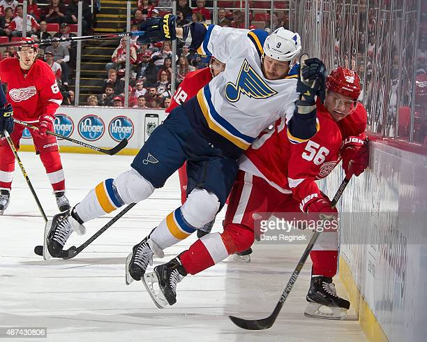 Steve Ott of the St Louis Blues leaves his skates to body check Teemu Pulkkinen of the Detroit Red Wings into the boards during a NHL game on March...