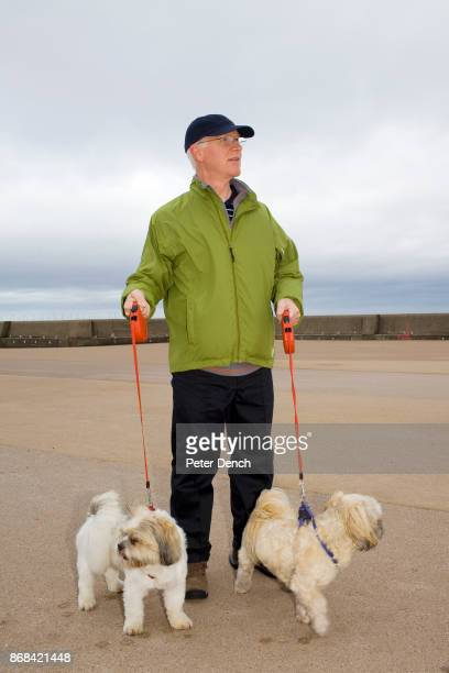 Steve out walking dogs Bobby and Rocky along King's Parade in New Brighton In 1986 world famous photographer Martin Parr published his book 'The Last...