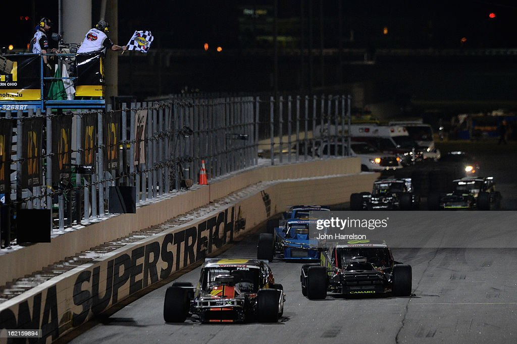 Steve Park, driver of the #20 UNOH Ford, takes the checkered flag to win the Whelen Modified Series UNOH Battle At The Beach at Daytona International Speedway on February 19, 2013 in Daytona Beach, Florida.