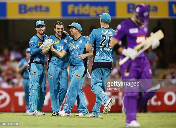 Steve Parry of the Heat celebrates with team mates after taking the wicket of Travis Birt of the Hurricanes during the Big Bash League match between...