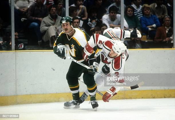 Steve Payne of the Minnesota North Stars skates on the ice as Joe Cirella of the New Jersey Devils trips on December 4 1986 at the Brendan Byrne...