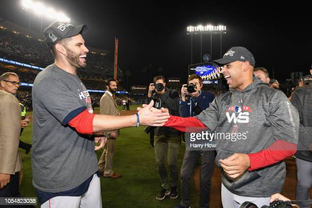 Steve Pearce and Alex Cora of the Boston Red Sox celebrate their teams 51 win over the Los Angeles Dodgers in Game Five to win the 2018 World Series...