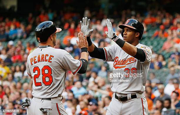 Steve Pearce and Jimmy Paredes of the Baltimore Orioles celebrate after they both scored runs in the second inning during their game against the...