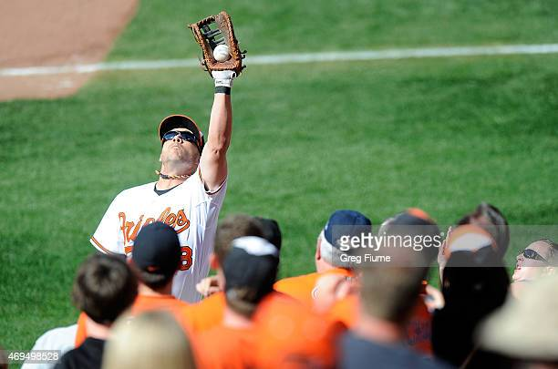 Steve Pearce of the Baltimore Orioles catches a foul ball hit by Edwin Encarnacion of the Toronto Blue Jays in the sixth inning at Oriole Park at...