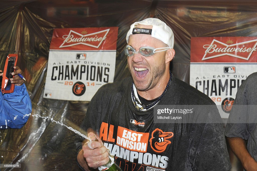Steve Pearce #28 of the Baltimore Orioles celebrates in locker room after Orioles clinch the American League East Division after a baseball game against the Toronto Blue Jays on September 16, 2014 at Oriole Park at Camden Yards in Baltimore, Maryland.