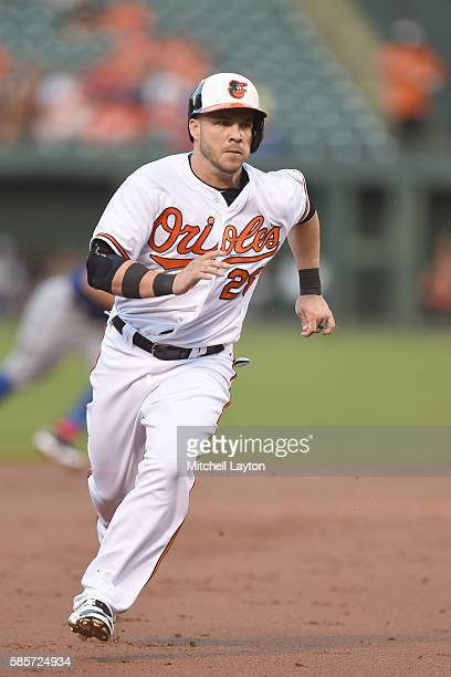 Steve Pearce of the Baltimore Orioles runs to third base in the first tinning during a baseball game against the Texas Rangers at Oriole Park at...