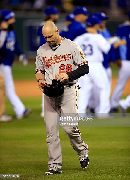 Steve Pearce of the Baltimore Orioles walks back to the dugout after being defeated by the Kansas City Royals 2 to1 in Game Three of the American...