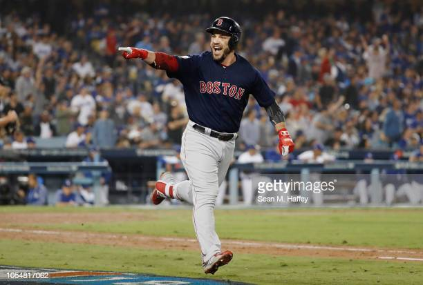 Steve Pearce of the Boston Red Sox celebrates his eighth inning home run against the Los Angeles Dodgers in Game Five of the 2018 World Series at...