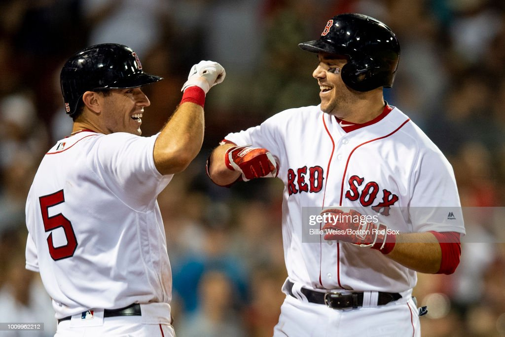 Steve Pearce #25 of the Boston Red Sox high fives Ian Kinsler #5 after hitting a two-run home run during the sixth inning of a game against the New York Yankees on August 2, 2018 at Fenway Park in Boston, Massachusetts. It was his third home run of the game.