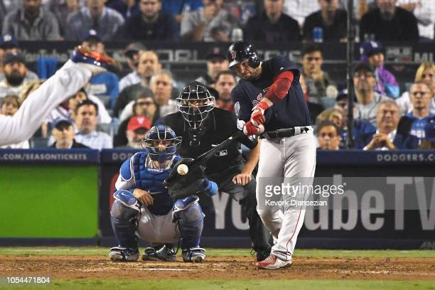 Steve Pearce of the Boston Red Sox hits a solo home run in the eighth inning of Game Four of the 2018 World Series against the Los Angeles Dodgers at...
