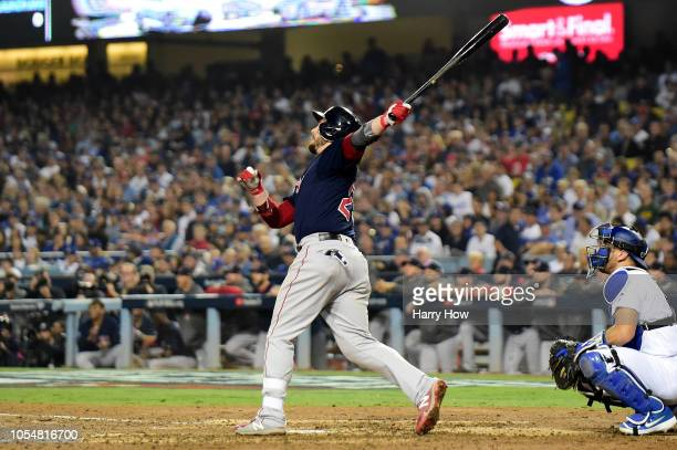Steve Pearce of the Boston Red Sox hits an eighth inning home run against the Los Angeles Dodgers in Game Five of the 2018 World Series at Dodger...