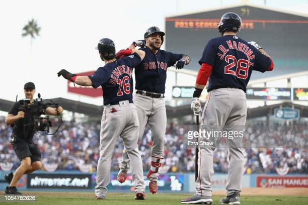 Steve Pearce of the Boston Red Sox is congratulated by his teammates Andrew Benintendi and J.D. Martinez after his first inning two-run home run...