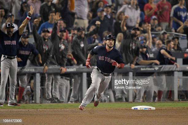 Steve Pearce of the Boston Red Sox rounds first base after hitting a solo home run in the eighth inning of Game Four of the 2018 World Series against...