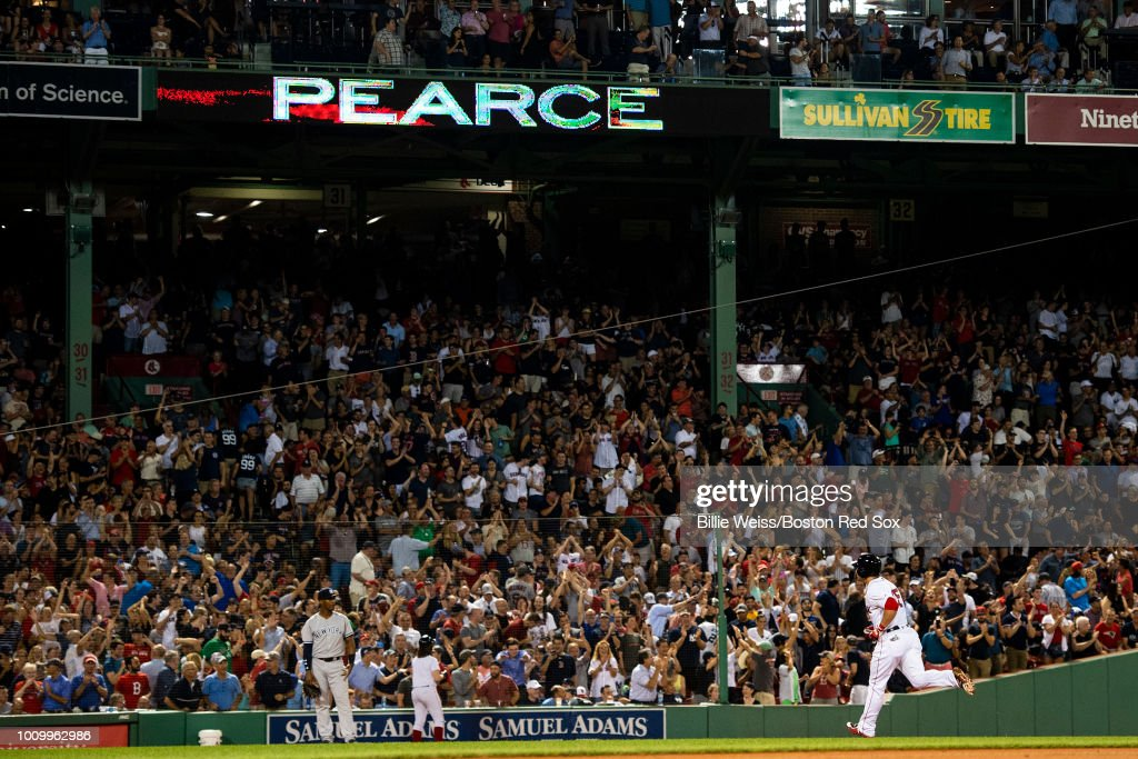 Steve Pearce #25 of the Boston Red Sox rounds the bases after hitting a two-run home run during the sixth inning of a game against the New York Yankees on August 2, 2018 at Fenway Park in Boston, Massachusetts. It was his third home run of the game.